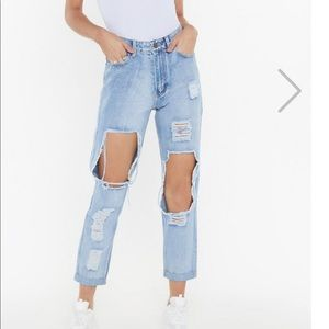 Overly distressed mom jeans